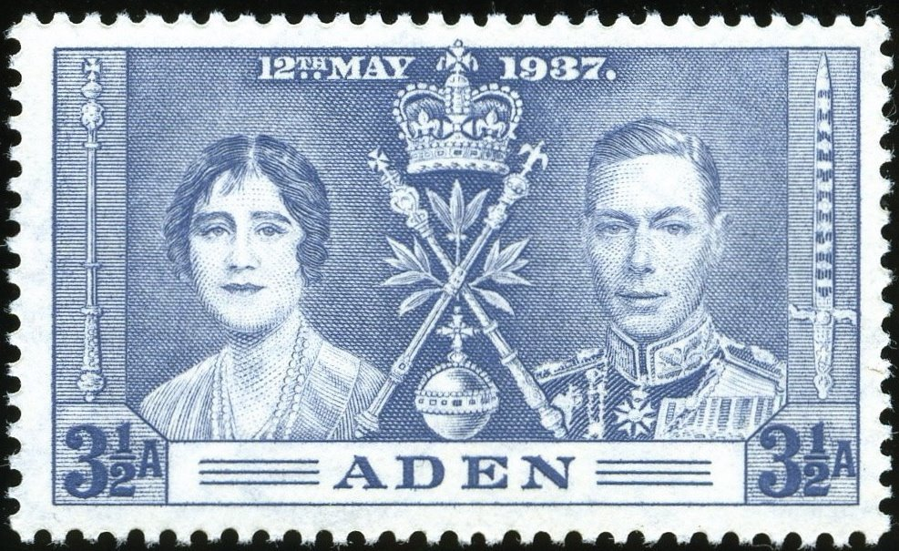 The Royal Couple and insignia of the Crown