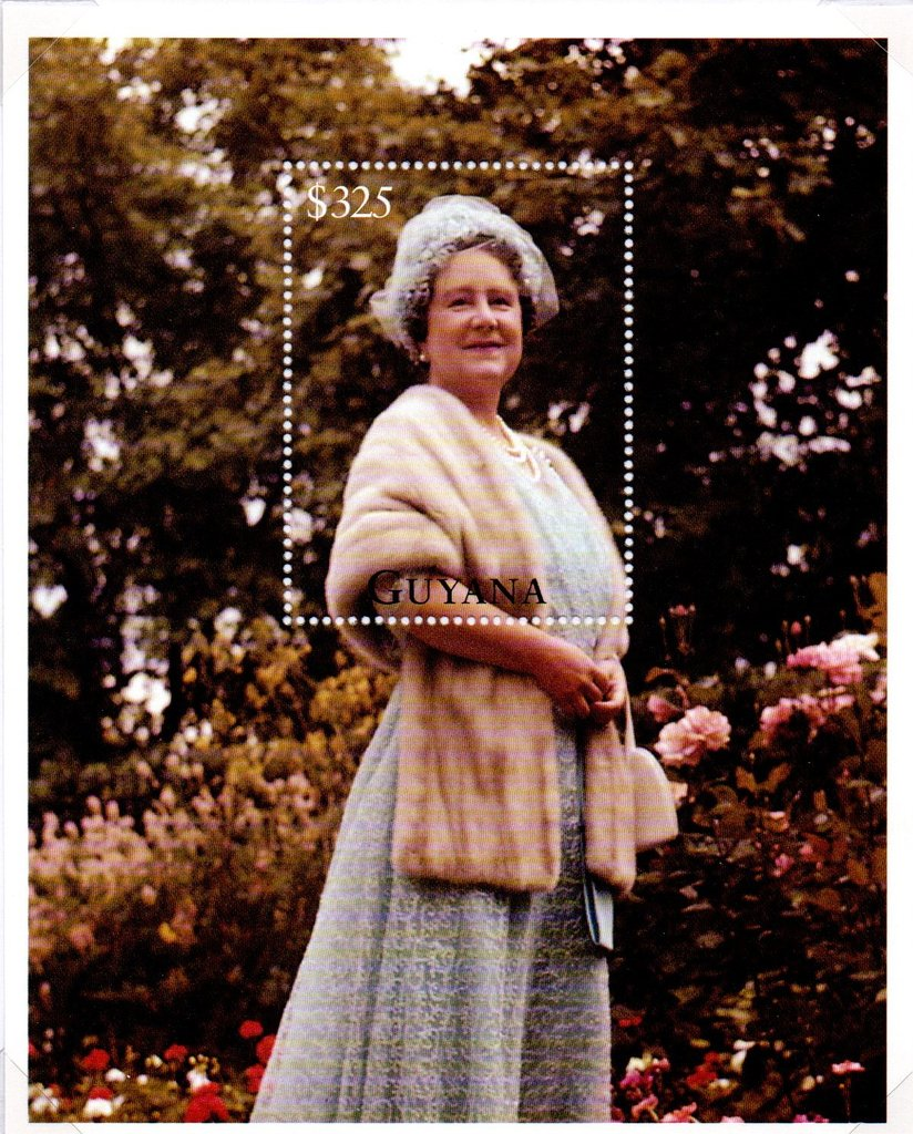 Queen Mother in blue dress and a mink stole